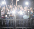 Crowd of young female fans screaming and cheering at concert Royalty Free Stock Photos
