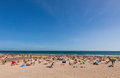 Crowded atlantic summer beach in portugal carcavelos town Royalty Free Stock Photo