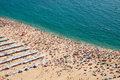 Crowded beach in nazare the of portugal seen from above Stock Photos