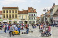 Crowded council square brasov romania unidentified people wander socialize and enjoy a sunny day in on march in th largest and the Stock Photo