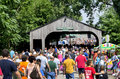 Crowded event and covered bridge Royalty Free Stock Photo