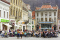 Crowded sidewalk cafe unidentified locals and tourists socialize eat and drink in cafes on march in council square in brasov th Stock Photos