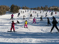 Crowded ski slope on a perfect sunny day Royalty Free Stock Image