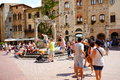 Crowded square with fountain in san gimignano italy Royalty Free Stock Image