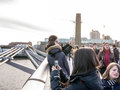 Crowds on millennium bridge with couple taking selfie in the foreground london uk girl tourist photo and photo is surrounded by Stock Photos
