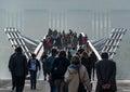 Crowds on Millennium Bridge, London Royalty Free Stock Photo