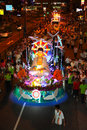 Crowds parading with floats a Wesak Procession Royalty Free Stock Image