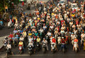 Crowed urban traffic in rush hour vietnam ho chi minh city viet nam mar amazing scene of crowd of people wear helmet ride Royalty Free Stock Photos