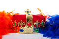 Crown and colroful feathers in dutch flag for kingsday over white background Royalty Free Stock Photo