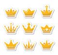 Crown royal family icons set king queen gold labels isolated on white Royalty Free Stock Photography