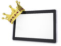 The crown on a tablet pc isolated render white background Royalty Free Stock Photography