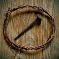 The crown of thorns of Jesus Christ and a nail on the Holy Cross Royalty Free Stock Photo