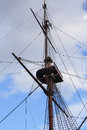 Crows nest on the mast of a old frigate amsterdam anchored at maritime museum in harbor amsterdam Royalty Free Stock Image