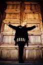 Crucified woman in church wooden door Stock Photos