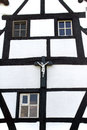 Crucifix against facade of a half timbered house netherlands cross with image jesus christ on the wall farm home in the village Stock Photo