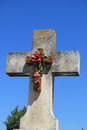 Crucifix with ceramic flowers at a french cemetery Royalty Free Stock Photos