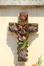 Crucifix with ceramic flowers at a french cemetery Stock Images