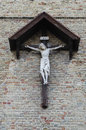 Crucifix christ on the against a brick wall Stock Image