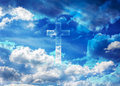 crucifix or cross form shining on puffy clouds blue sky, heaven Royalty Free Stock Photo