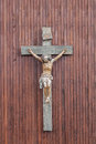 Crucifix with figure of jesus on a wooden background Royalty Free Stock Photography