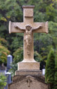 Crucifix old weathered stone statue of jesus christ in a cemetery Stock Photography