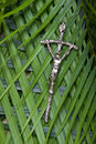 Crucifix On Palm Leaves Royalty Free Stock Image