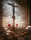 Crucifix and prayer candles Royalty Free Stock Photo