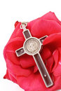 Crucifix on Red Rose Stock Photo