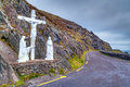 Crucifix at the road on dingle peninsula ireland Stock Photos