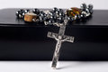 Crucifix rosary on bible lays or prayer book Royalty Free Stock Image