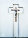 Crucifix on a wall of a house as symbol for christianity Stock Photos