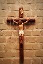 Crucifix on wall in spotlight. Jesus Christ on cross. Royalty Free Stock Photo