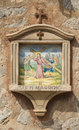 Crucifixion of the christ ceramic tile on house wall deia spain Stock Photography