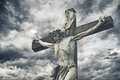 Crucifixion christian cross with jesus christ statue over storm stormy clouds religion and spirituality concept Stock Photography