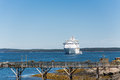 Cruise ship beyond old wood pier a large luxury moored in the bay off of bar harbor maine an Stock Photo