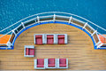 Cruise ship deck with blue water in background Royalty Free Stock Images