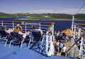 Cruise Ship  - Deck Chairs and Island Views Stock Image