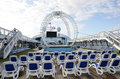 Cruise ship on deck are the pools a stage under the high flyer cirque du soleil apparatus the big out door movie screen or maybe Royalty Free Stock Photo