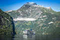 Cruise ship in Geiranger fjord, Norway  August 5, 2012 Royalty Free Stock Photo