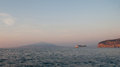 The cruise ship in the gulf of naples arrives to sorrento at sunset vesuvius mount on background Royalty Free Stock Photography