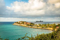 Cruise ship on the horizon with tropical resort of Sint Maarten