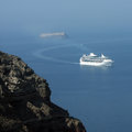 Cruise ship near of the coast of island Santorini Stock Photo