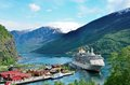 Cruise ship on norwegian fjord a docked in the village of flåm in norway flåm is a village at the inner end of the the of Stock Image