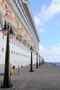 Cruise ship and pier lamposts docked in saint kitts next to the concrete with lampposts Royalty Free Stock Photo