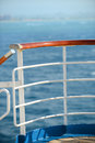 Cruise ship rails passenger with ocean in background Royalty Free Stock Photo