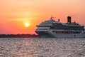 Cruise ship a with the sunset in the background Stock Photos