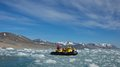 Cruising along Monaco Glacier in Svalbard Royalty Free Stock Photo