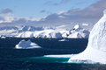 Cruising down the gerlache strait antarctica beautiful icebergs float in ocean with sculpted shapes under a sunny blue sky Stock Photo