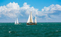 Cruising yachts are racing of regatta sailing nautical landscape with two yacht under full sail taking part in regatta race Stock Images