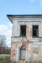 Crumbling brick house angle two story black holes windows look sharp Royalty Free Stock Photos